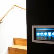 Residential interior photograph demonstrating AV media installation in a hallway , London