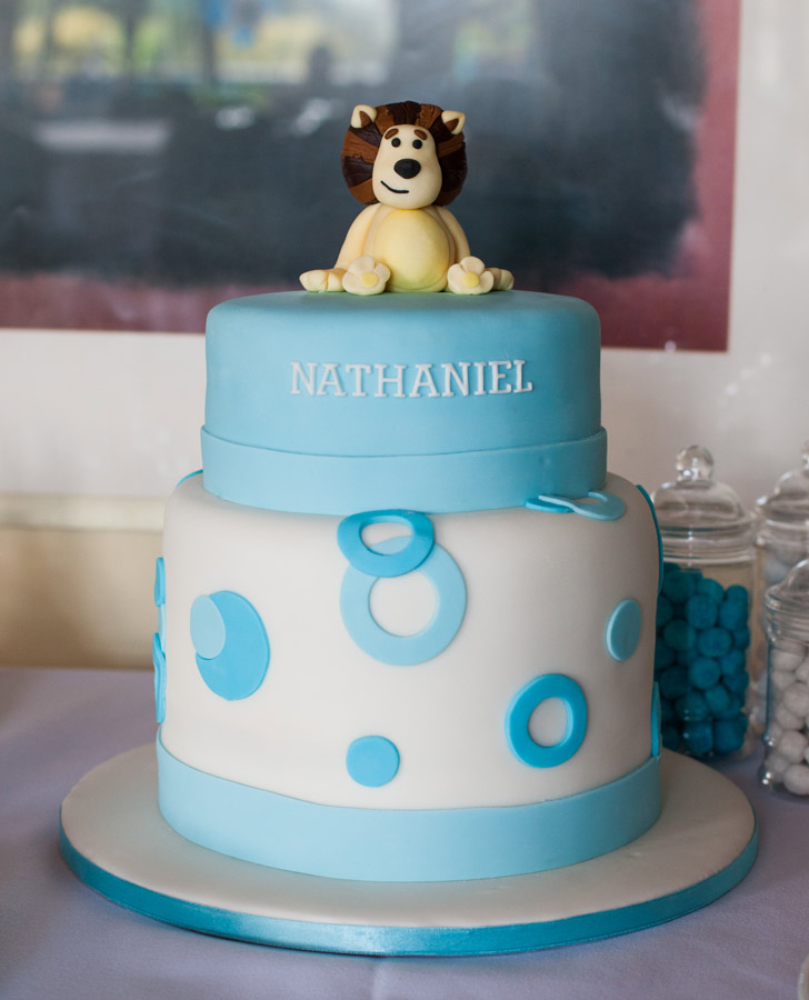 1st birthday party cake in blue with a lion on top