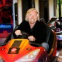 Richard Branson riding in a dodgem bumper car