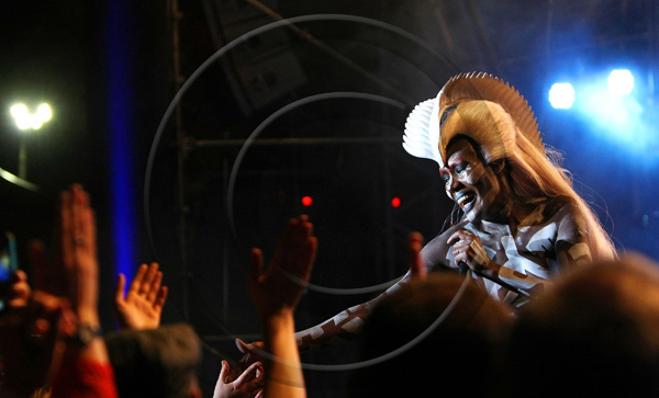Grace Jones touches hands with fans in the crowd as she performs on stage at Festival No 6 on September 6, 2015 in Portmeirion, Wales.