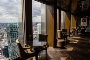 Image showing the art deco styled interior and the London skyline view from the Michelin starred City Social restaurant, Tower 42, The City, London, owned by chef Jason Atherton.